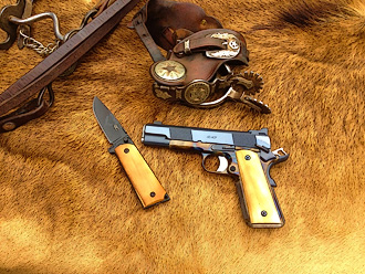 Custom 1911, knife and spurs