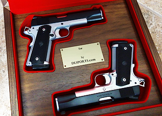pair of 1911s in custom display case